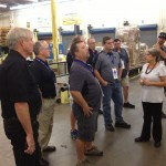 Automotive experts on the tour learned about ever part of the complex filter manufacturing process.