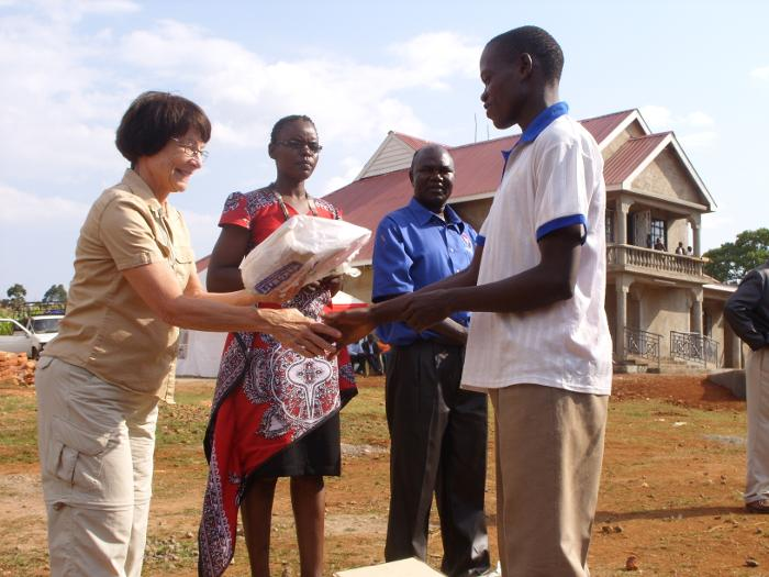Darlene Hess (left) Meeting Community Partners in Kenya, Including Pastor  Chuchu (blue shirt), a Prominent Community Leader